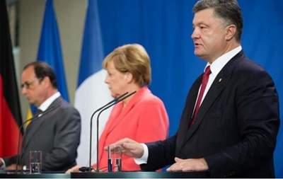 Порошенко обсудил с Меркель и Оландом выполнение минских соглашений